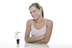 Young woman holding young sprout in the hands. Stock Photo