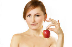 The young woman holds apple in hand Stock Photography