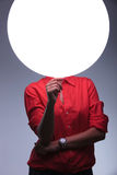 Young woman holds a blank circle in front of face Royalty Free Stock Photos