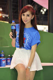A young woman holds a bottle of carbonated drink royalty free stock image