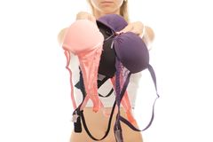 Young woman holds bras. On white background isolated Stock Image