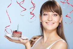 Young woman holds cake with candle Stock Image