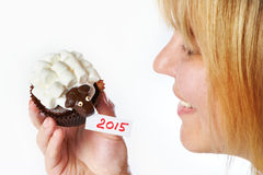 Young woman holds cake lamb as simbol 2015 new years isolated Royalty Free Stock Image