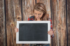 Young woman holds a chalkboard sign Stock Images