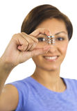 Young woman holds coins between her fingers Stock Photos