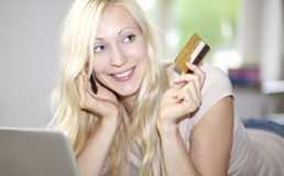 Young woman holds credit card Royalty Free Stock Photo
