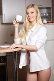 Young woman holds a cup of coffe Royalty Free Stock Images