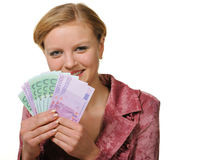 The young woman holds the European currency Stock Image