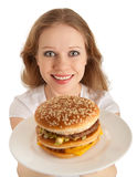 Young woman holds fast food, hamburger Royalty Free Stock Photos