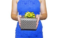 Young woman holds gift box in hand closeup isolated on white background. Gift for Holidays celebration concept.  Royalty Free Stock Photos