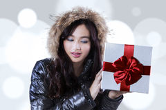 Young woman holds a gift box Stock Images
