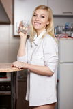 Young woman holds a glass with water Stock Photos