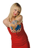 The young woman holds the globe in hands Stock Photos
