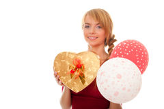 Young woman holds gold gift box and balloons Stock Images