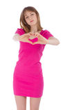 The young woman holds hands in the form of heart stock image