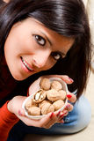 Young woman holds in her hand a little nuts Stock Photos