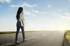 Young woman holds a laptop on the road Stock Photos