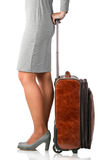 Young woman holds leather suitcase Royalty Free Stock Images