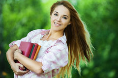 Young woman holds lot books Royalty Free Stock Photography