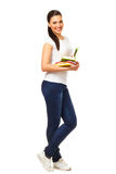 Young woman holds open books. Isolated on white background Royalty Free Stock Photography