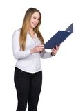 Young woman holds an opened file Stock Photos