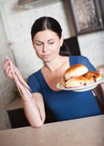 Young woman holds pie and a measuring tape Stock Photos