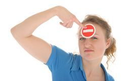 Young woman holds prohibiting sign before forehead Stock Image
