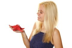 Young woman holds a red starfish Stock Photos