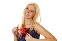 Young woman holds a red starfish Royalty Free Stock Photography