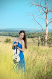Young woman holds violin Royalty Free Stock Photography