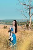 Young woman holds violin Royalty Free Stock Image