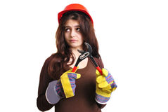 Young woman holds a water pipe wrench. A young woman holds a water pipe wrench Royalty Free Stock Photography