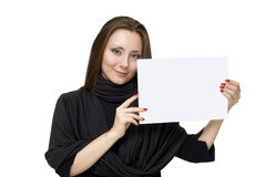 Young woman holds the white sheet of paper. Isolated Stock Photos
