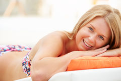 Young Woman On Holiday Relaxing By Swimming Pool Stock Images