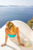 Young woman on holidays, Santorini Oia town Stock Images