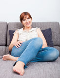 Young woman at home Stock Images