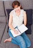 Young woman at home Royalty Free Stock Images