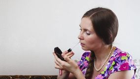 Young woman at home applying make up stock video footage