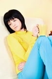 Young woman at home. Contemplate woman at home on sofa Stock Image
