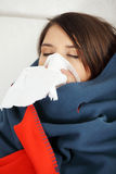 Young woman at home having flu. Stock Photos