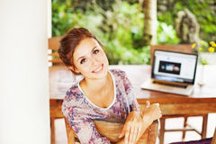 Young woman at home with laptop Royalty Free Stock Images