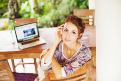 Young woman at home with laptop stock photo