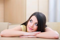 Young woman at home looking up Stock Photography