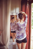 Young woman at home near the mirror Royalty Free Stock Photography
