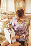 Young woman at home packing bag Royalty Free Stock Photo