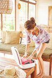 Young woman at home packing bag Stock Photos