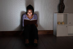 Young woman at home screams reading spooky book Stock Photos