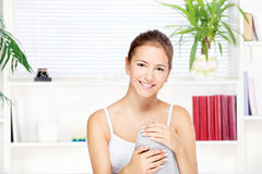 Young woman at home sitting on the sofa Stock Photo