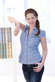 Young woman at home standing by bookshelf Stock Photography