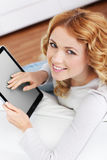 Young woman at home with touchpad Stock Images